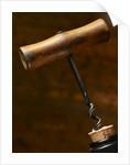 Old-Fashioned Corkscrew Uncorking Bottle by Corbis