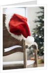 Santa hat on chair by Corbis