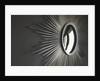 Wall hanging with mirror and rays by Corbis