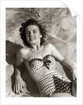 1950s Brunette Woman Wear Polka Dot Two Piece Bathing Suit Laying On Sand by Corbis