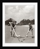 1930s 1940s 2 Boys With Sticks And Puck Wearing Roller Skates Playing Street Hockey by Corbis