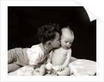 1940s Curly Haired Boy Toddler Leaning And Kissing Cute Baby by Corbis
