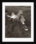 1960s Boy Sleeping In Grass Legs Crossed Holes In Sneakers Baseball Mitt By His Side by Corbis