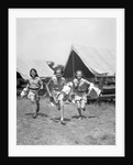 1930s Three Teen Girls Wearing Camp Shorts and Shirts Running From Tents While Holding Towels and Wash Basins by Corbis