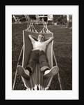 1950s Relaxed Boy Lying In Suburban Backyard Hammock by Corbis