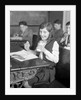 1920s School Girl Eating Lunch At Her Desk Drinking From A Bottle Of Milk Holding A Sandwich by Corbis