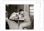 1950s 1960s Laughing Teenage Boy and Girl Sharing Drink Together With Two Straws In Soda Shop by Corbis