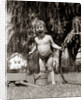 1940s 1950s Wet Young Boy Toddler Outside Playing With Water Hose by Corbis