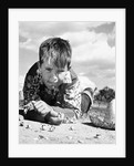 1950s Boy Shooting Marbles Outdoor by Corbis