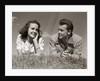 1940s Teenage Couple Lying In Grass Romance Boy Girl Outdoor by Corbis
