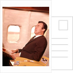 1960s Man Sitting In First Class Airplane Passenger Seat by Corbis