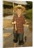 1950s Boy Straw Hat Holding Fishing Pole Wearing Plaid Shirt Blue Jeans by Corbis