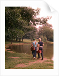 1970s 1960s Two Boys Walking Beside Fishing Pond by Corbis