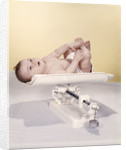 1950s 1960s Baby Lying On Weight Scale by Corbis