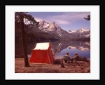 1970s Elderly Couple Camping Sitting By Red Tent Stanley Lake Idaho by Corbis