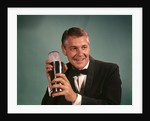 1960s 1970s Bartender Man In Black Tuxedo Mixing Cocktail In Shaker by Corbis