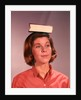 1960s 1970s Young Woman Girl Balancing Book On Head by Corbis