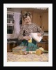 1960s Woman Housewife Mother Wearing Apron In Kitchen Pouring Milk Into Thermos For School Lunch by Corbis