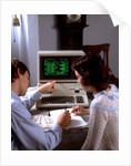 1980s Teenage Couple Boy And Girl Working Together On Apple Iii Personal Computer by Corbis
