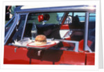 Food Tray On Antique Car Window by Corbis
