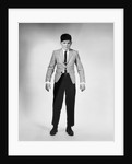 1950s 1960s Overgrown Boy In Tight Suit by Corbis