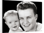 1940s Portrait Of Father Holding Baby Daughter To Cheek by Corbis
