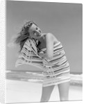 1950s 1960s Woman Wrapped In Stripped Towel Drying Hair On Beach Smiling by Corbis