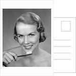 1950s Woman Holding Tooth Brush by Corbis
