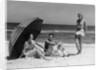 1930s Two Women 1 Man Sitting Under Beach Umbrella Wearing Fashionable Swimwear by Corbis