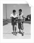 1930s Two Boys Walking School Reading Books by Corbis