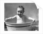 1930s Wet Baby In Washtub Sticking Out Tongue by Corbis