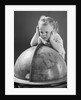 1940s Baby Looking At Leaning On Globe Of Earth by Corbis