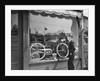 1950s Boy On Sidewalk Looking At Bicycle In Store Window by Corbis