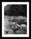 1920s Man In Stream Wearing Waders With Fish On Line Trying To Catch It In Net by Corbis