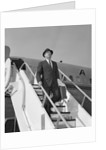 1960s Businessman Deplaning From Airplane Wearing Hat And Carrying Overcoat And Briefcase by Corbis