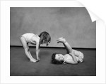 1930s Two Girls Wearing Underclothes Playing At Exercising by Corbis