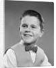 1950s Boy Portrait Wearing Checked Vest Polka Dot Bow Tie School Picture by Corbis