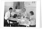 1950s Family Sitting At Kitchen Table Having Breakfast by Corbis