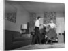 1950s Teen Couple Doing Jitterbug Rock And Roll Dance In Living Room Man Woman Boy Girl by Corbis