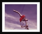 1960s Nozzle Handle Of Gasoline Pump With Blue Sky Background by Corbis