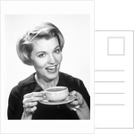 1960s Woman Drinking Coffee Holding Cup And Saucer by Corbis