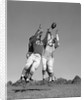 1960s Three Football Players Reaching To Catch Ball by Corbis