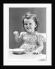 1940s 1930s Little Girl Eating Bowl Of Ice Cream by Corbis
