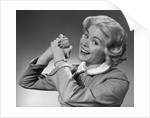 1950s 1960s Woman Making Winning Symbolic Hand Gesture With Raised Clasped Hands by Corbis