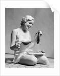 1930s Woman In Silk Teddy Lingerie Opening A Box Of Hosiery by Corbis