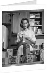 1960s Woman Housewife In Kitchen Checking Grocery Food Shopping List by Corbis