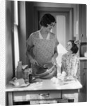1920s 1930s Mother With Mixing Bowl In Kitchen With Daughter by Corbis
