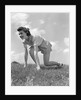1940s Young Teen Woman Kneeling In Grass In Track Race Ready Starting Position by Corbis