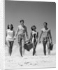 1960s Teenage Couples Wearing Bathing Suits On Beach Carrying Picnic Baskets by Corbis