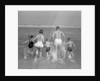 1960s Back View Of Family Of 5 Holding Hands Running Into Ocean by Corbis